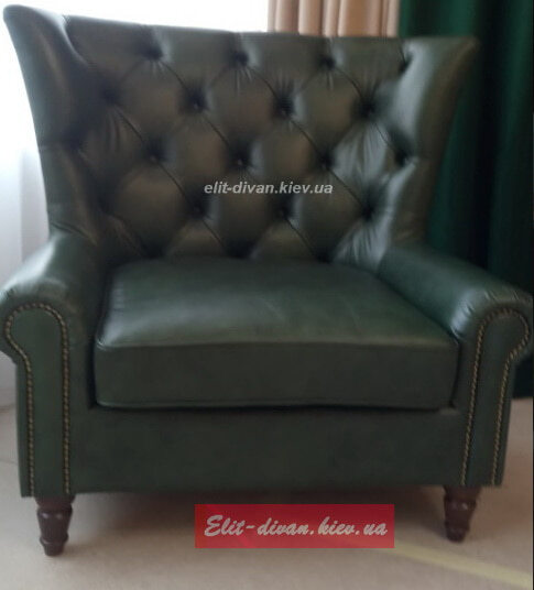 зеленое кресло из кожи
